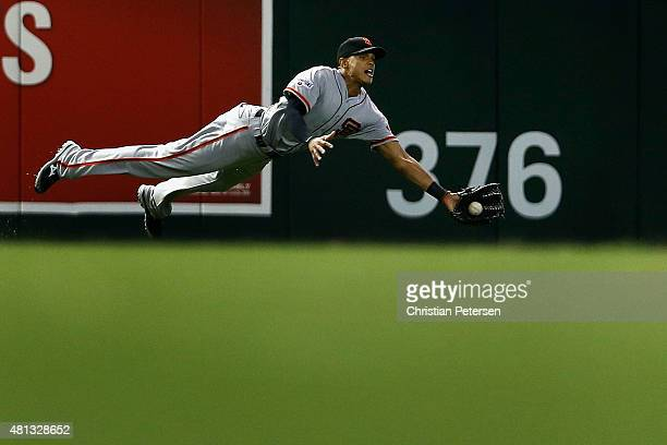 Outfielder Justin Maxwell of the San Francisco Giants makes a diving catch during the fifth inning of the MLB game against the Arizona Diamondbacks...