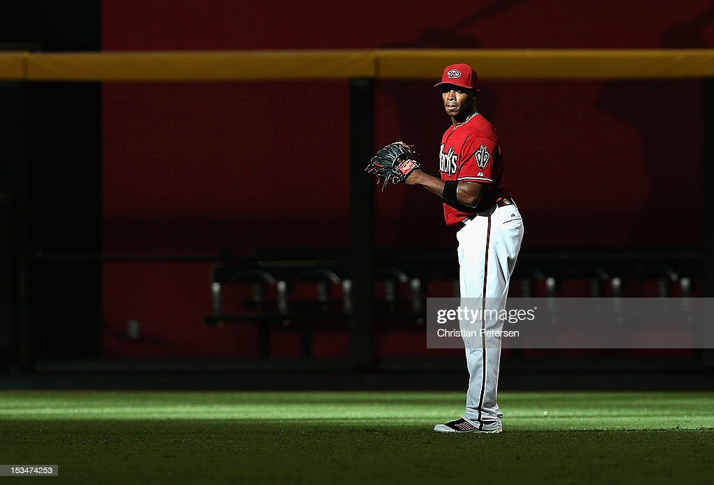 Outfielder <a gi-track='captionPersonalityLinkClicked' href=/galleries/search?phrase=Justin+Upton&family=editorial&specificpeople=846265 ng-click='$event.stopPropagation()'>Justin Upton</a> #10 of the Arizona Diamondbacks warms up before the MLB game against the Colorado Rockies at Chase Field on October 3, 2012 in Phoenix, Arizona.