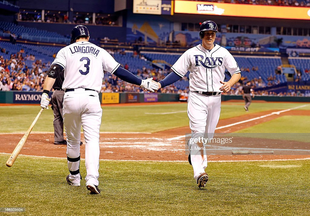 Outfielder Kelly Johnson #2 of the Tampa Bay Rays is congratulated by <a gi-track='captionPersonalityLinkClicked' href=/galleries/search?phrase=Evan+Longoria&family=editorial&specificpeople=2349329 ng-click='$event.stopPropagation()'>Evan Longoria</a> #3 after scoring against the Toronto Blue Jays during the game at Tropicana Field on May 8, 2013 in St. Petersburg, Florida.