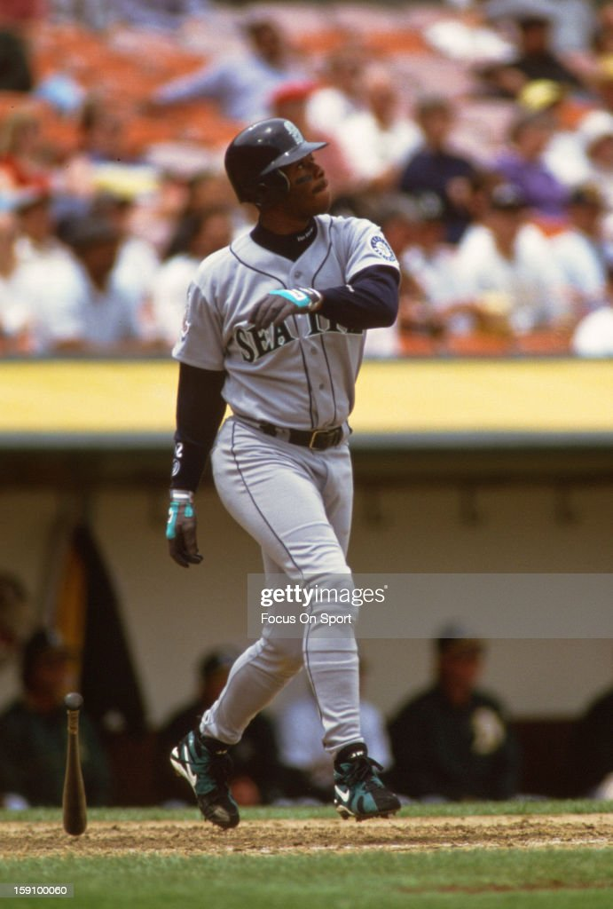 Outfielder Ken Griffey Jr. #24 of the Seattle Mariners bats against the Oakland Atheltics during an Major League Baseball game circa 1995 at the Oakland-Alameda County Coliseum in Oakland, California. Griffey played for the Mariners from 1989-99 and 2009-2010.
