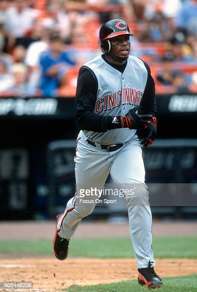 Outfielder Ken Griffey Jr of the Cincinnati Reds puts the ball in play and runs up the first base line against the New York Mets during an Major...