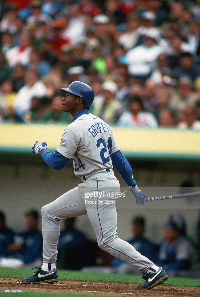 Outfielder Ken Griffey Jr #24 of the Seattle Mariners bats against the Oakland Atheltics during an Major League Baseball game circa 1989 at the Oakland-Alameda County Coliseum in Oakland, California. Griffey played for the Mariners from 1989-99 and 2009-2010.