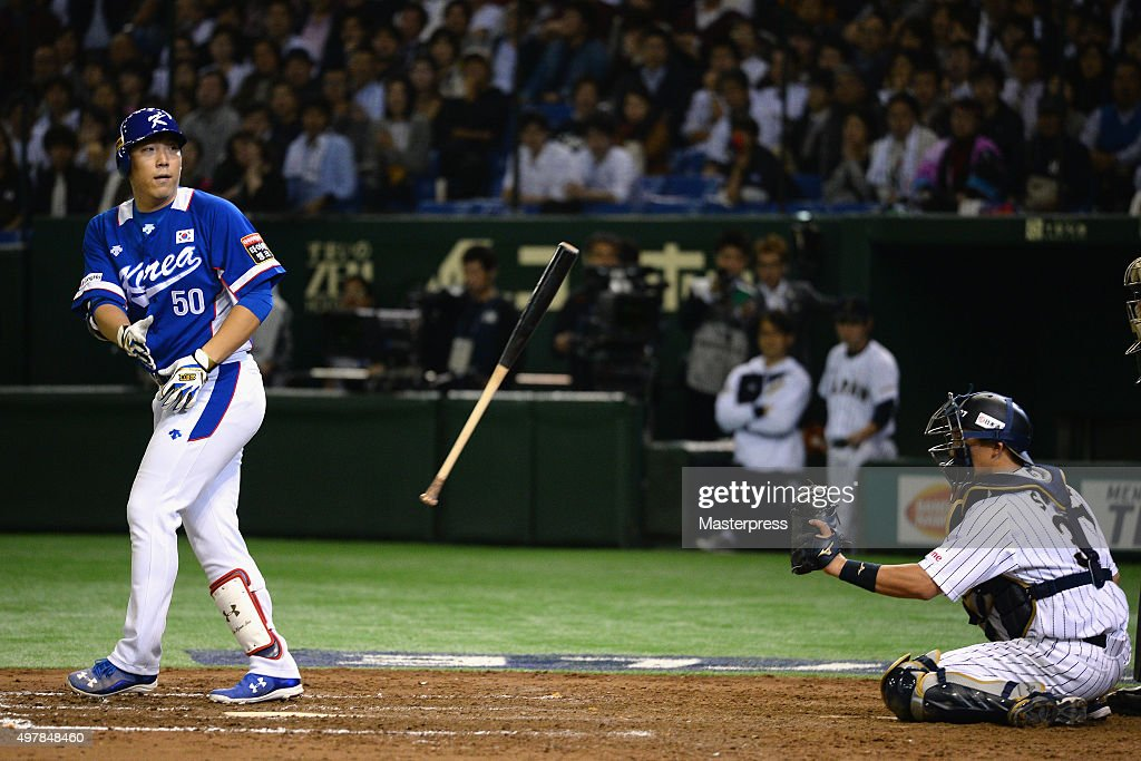 Outfielder Kim Hyunsoo #50 of South Korea throws the bat as he is given a run-scoring walk in the top of ninth inning during the WBSC Premier 12 semi final match between South Korea and Japan at the Tokyo Dome on November 19, 2015 in Tokyo, Japan.