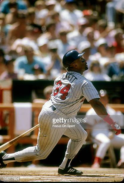 Outfielder Kirby Puckett of the Minnesota Twins swings and watches the flight of his ball against the California Angels circa 1989 during a MLB...