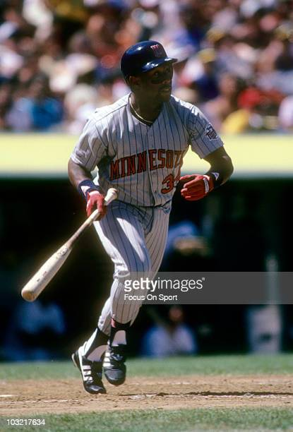Outfielder Kirby Puckett of the Minnesota Twins swings and watches the flight of his ball against the Oakland Athletics circa 1987 during a MLB...