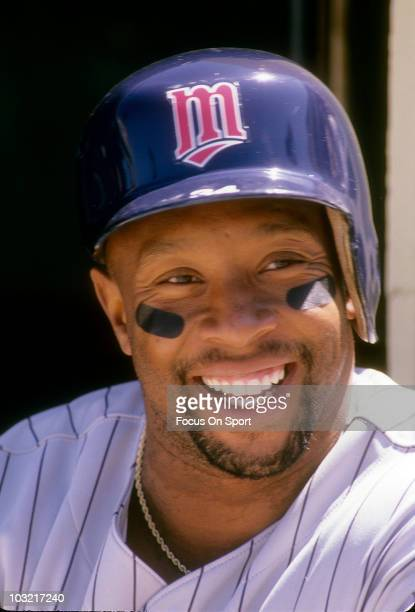 Outfielder Kirby Puckett of the Minnesota Twins swings in this portrait sitting in the dougout circa 1992 during an MLB baseball game against the...