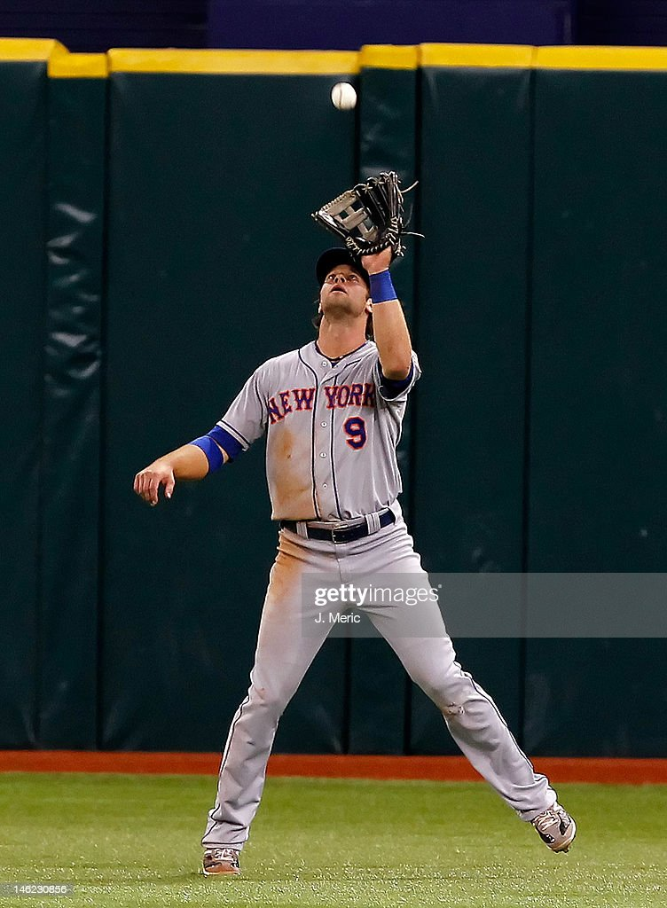 Outfielder Kirk Nieuwenhuis #9 of the New York Mets catches a fly ball against the Tampa Bay Rays during the game at Tropicana Field on June 12, 2012 in St. Petersburg, Florida.
