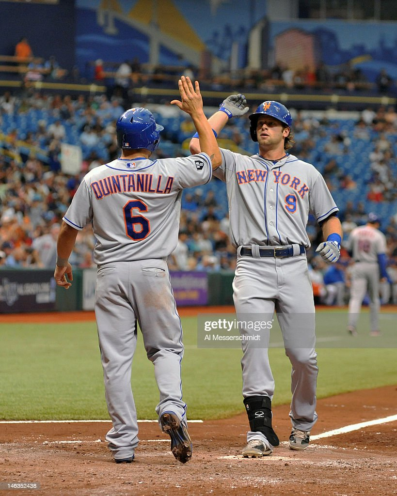 Outfielder Kirk Nieuwenhuis #9 of the New York Mets celebrates his second home run with Omar Quintanilla #6 during a game against the Tampa Bay Rays June 14, 2012 at Tropicana Field in St. Petersburg, Florida. The Mets won 9 - 6.