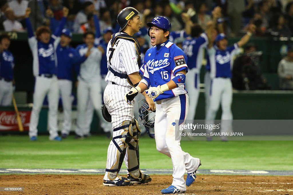 Outfielder Lee Yongkyu #15 of South Korea celebrates scoring by a two-run single of designated hitter Lee Dae Ho #10 of South Korea to make 4-3 in the top of ninth inning during the WBSC Premier 12 semi final match between South Korea and Japan at the Tokyo Dome on November 19, 2015 in Tokyo, Japan.
