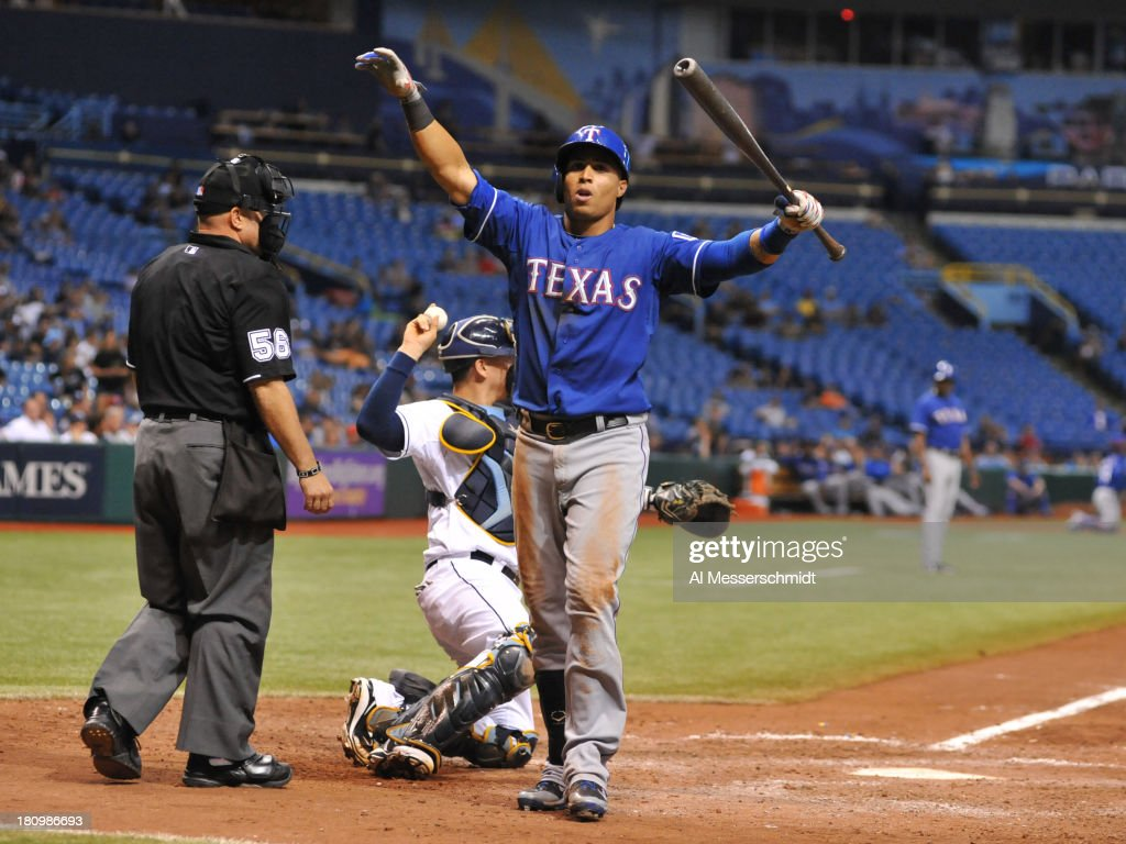 Outfielder Leonys Martin #2 of the Texas Rangers turns away from an inside pitch against the Tampa Bay Rays September 18, 2013 at Tropicana Field in St. Petersburg, Florida. The Rays won 4 - 3 in 12 innings.
