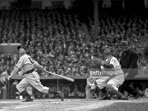 Outfielder Lloyd Waner of the Pittsburgh Pirates pops up a pitch as catcher Ernie Lombardi of the Cincinnati Reds looks to see if he has a play...