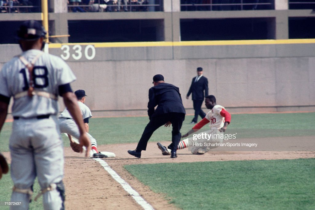 Outfielder <a gi-track='captionPersonalityLinkClicked' href=/galleries/search?phrase=Lou+Brock&family=editorial&specificpeople=207012 ng-click='$event.stopPropagation()'>Lou Brock</a> #20 of the St. Louis Cardinals slides into third base during a 1967 World Series game against the Boston Red Sox in October 7, 1967 at Busch Stadium in St. Louis, Missouri.