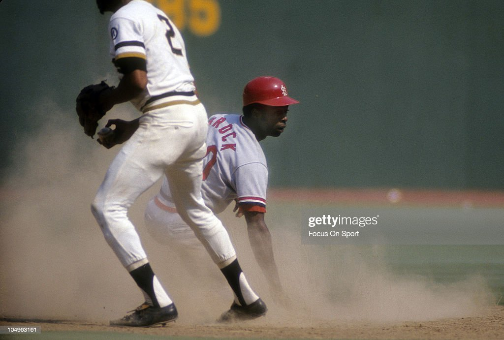 Outfielder Lou Brock #20 of the St. Louis Cardinals steals second base against the Pittsburgh Pirates during a Major League Baseball game circa 1973 at Three Rivers Stadium in Pittsburgh, Pennsylvania. Brock played for the Cardinals from 1964-79.