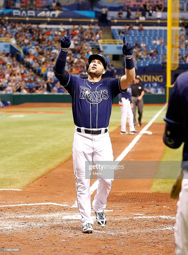 Outfielder <a gi-track='captionPersonalityLinkClicked' href=/galleries/search?phrase=Luke+Scott&family=editorial&specificpeople=757156 ng-click='$event.stopPropagation()'>Luke Scott</a> #30 of the Tampa Bay Rays celebrates his third inning two run home run against the Kansas City Royals during the game at Tropicana Field on June 15, 2013 in St. Petersburg, Florida.