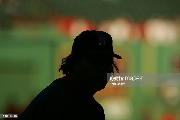 Outfielder Manny Ramirez of the Boston Red Sox attends batting practice before the game against the New York Yankees at Fenway Park on September 24...