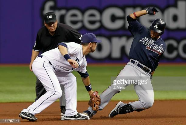 Outfielder Martin Prado of the Atlanta Braves steals second base as infielder Ben Zobrist of the Tampa Bay Rays is late with the tag during the game...