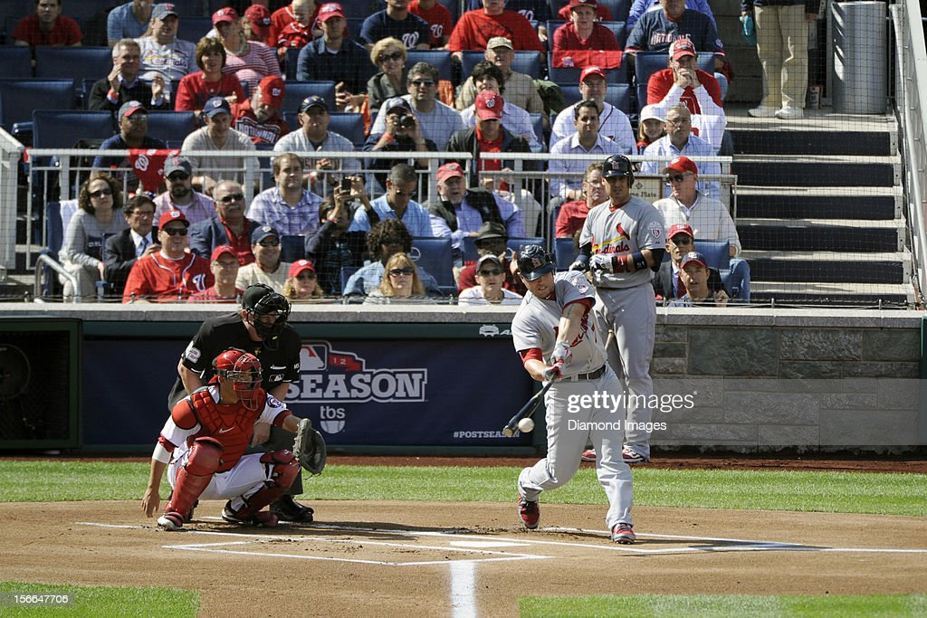 Outfielder Matt Holliday of the St Louis Cardinals hits a pitch during the top of the first inning of Game Three of the National League Division...