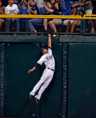 Outfielder Matt Joyce of the Tampa Bay Rays cannot come up with this sixth inning fly ball off the bat of catcher Josh Thole of the Toronto Blue Jays...