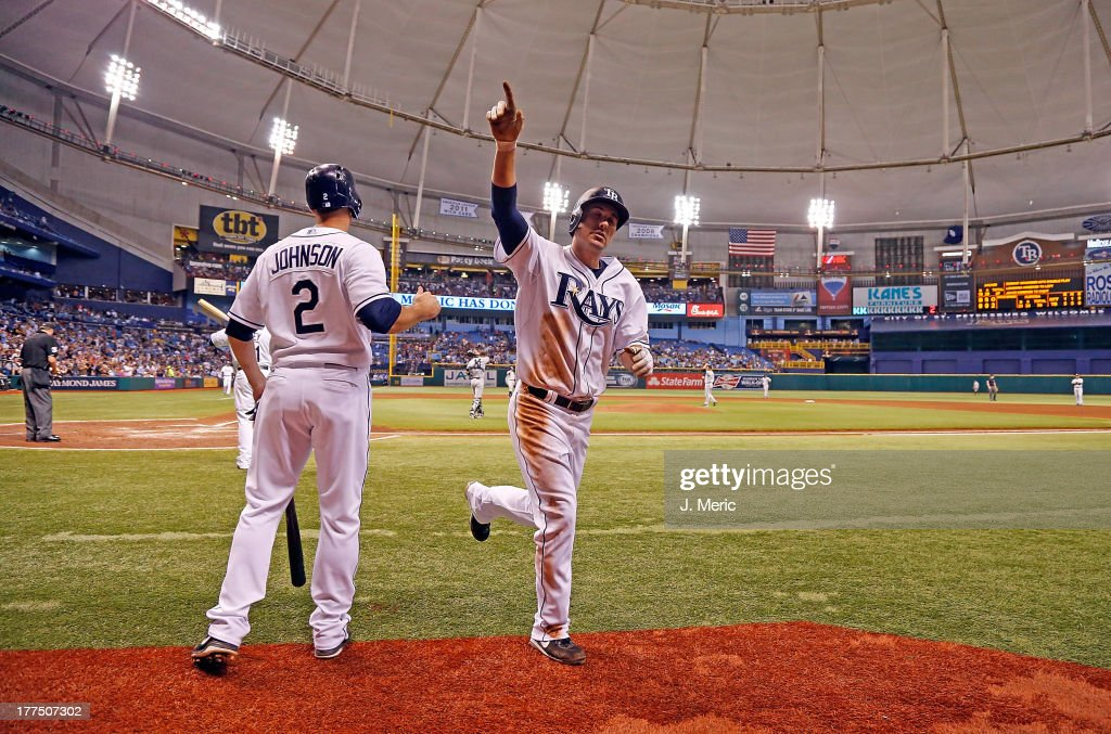 Outfielder Matt Joyce #20 of the Tampa Bay Rays celebrates his third inning home run against the New York Yankees during the game at Tropicana Field on August 23, 2013 in St. Petersburg, Florida.
