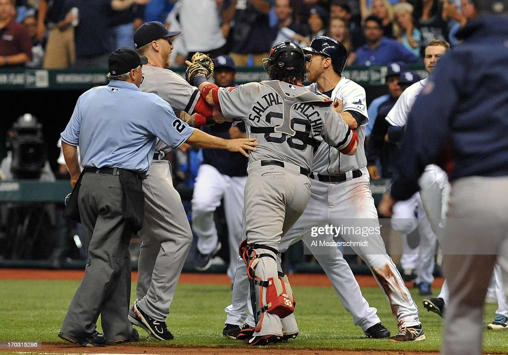 Outfielder Matt Joyce #20 of the Tampa Bay Rays confronts pitcher <a gi-track='captionPersonalityLinkClicked' href=/galleries/search?phrase=John+Lackey&family=editorial&specificpeople=171533 ng-click='$event.stopPropagation()'>John Lackey</a> #41 of the Boston Red Sox after Joyce was hit in the back by a pitch June 10, 2013 at Tropicana Field in St. Petersburg, Florida. Joyce homered in the game and Boston won 10 - 8 in 14 innings.