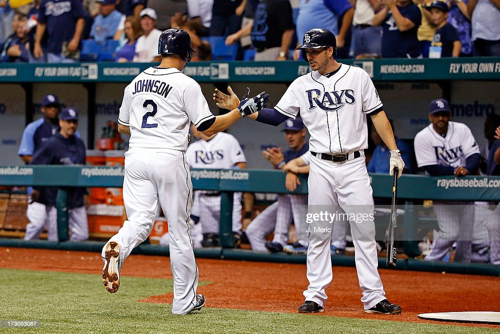 Outfielder Matt Joyce #20 of the Tampa Bay Rays congratulates Kelly Johnson #2 after his second-inning solo home run against the Chicago White Sox during the game at Tropicana Field on July 5, 2013 in St. Petersburg, Florida.