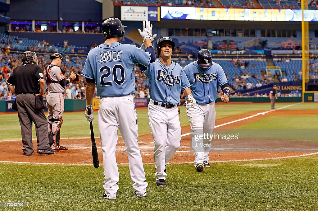 Outfielder Matt Joyce #20 of the Tampa Bay Rays congratulates <a gi-track='captionPersonalityLinkClicked' href=/galleries/search?phrase=Sam+Fuld&family=editorial&specificpeople=4505687 ng-click='$event.stopPropagation()'>Sam Fuld</a> #5 after his home run against the Baltimore Orioles during the game at Tropicana Field on June 9, 2013 in St. Petersburg, Florida.