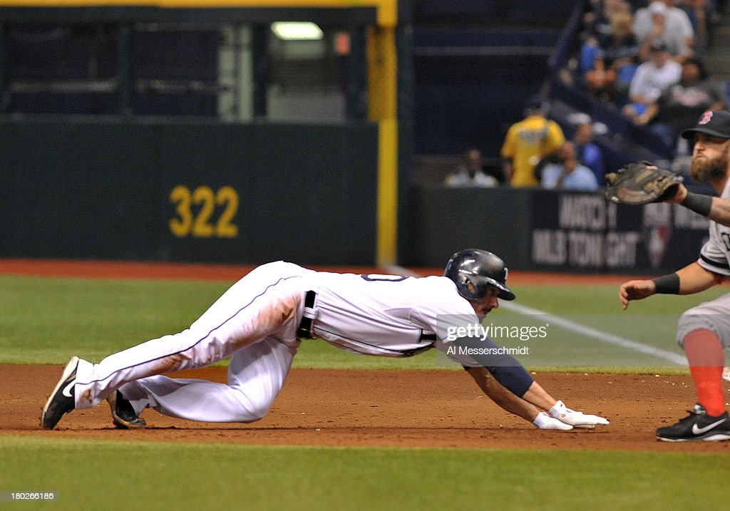 Outfielder Matt Joyce #20 of the Tampa Bay Rays dives into first base to avoid a pickoff in the 4th inning against the Boston Red Sox September 10, 2013 at Tropicana Field in St. Petersburg, Florida.