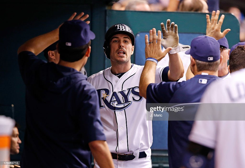 Outfielder Matt Joyce #20 of the Tampa Bay Rays is congratulated after scoring a run in the sixth inning against the Arizona Diamondbacks during the game at Tropicana Field on July 30, 2013 in St. Petersburg, Florida.