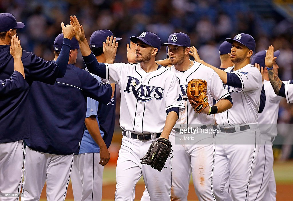 Outfielder Matt Joyce #20 of the Tampa Bay Rays is congratulated along with <a gi-track='captionPersonalityLinkClicked' href=/galleries/search?phrase=Evan+Longoria&family=editorial&specificpeople=2349329 ng-click='$event.stopPropagation()'>Evan Longoria</a> #3 after the Rays' victory over the Oakland Athletics at Tropicana Field on April 20, 2013 in St. Petersburg, Florida.