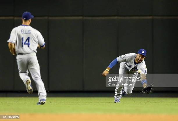 Outfielder Matt Kemp of the Los Angeles Dodgers makes a diving catch on a ball hit by Aaron Hill of the Arizona Diamondbacks during the MLB game at...