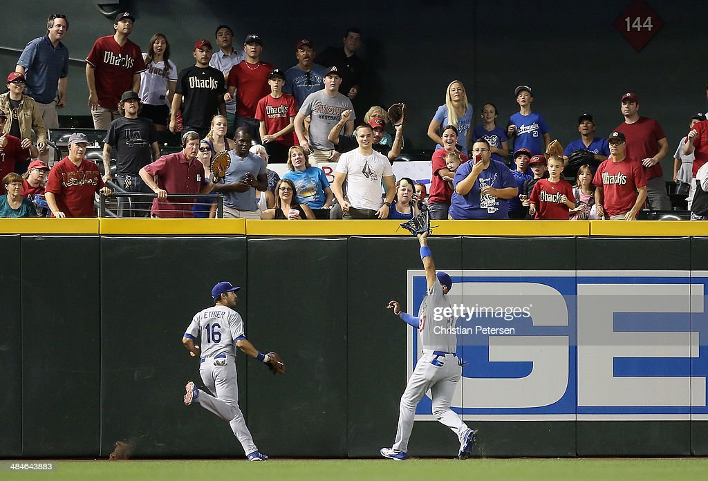 Outfielder Matt Kemp #27 of the Los Angeles Dodgers makes a running catch during the fifth inning of the MLB game against the Arizona Diamondbacks at Chase Field on April 13, 2014 in Phoenix, Arizona.