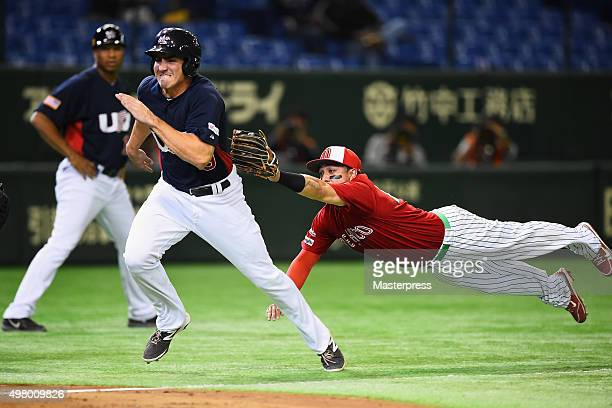 Outfielder Matt McBride of the United States is tagged out by Brandon Macias of Mexico in the bottom of fourth inning during the WBSC Premier 12 semi...