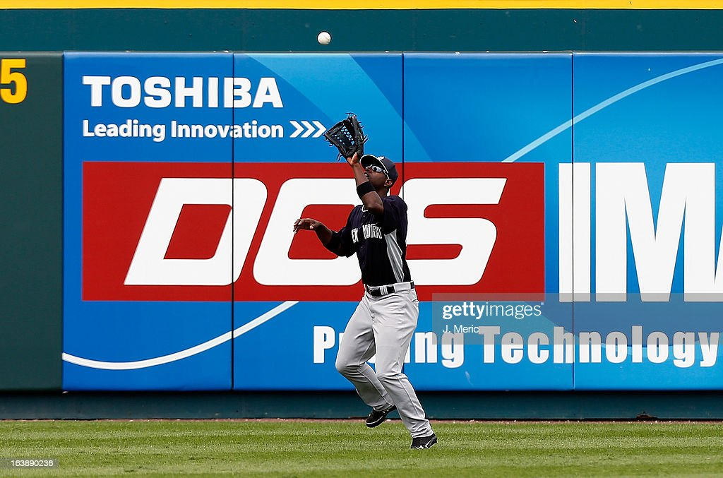 Outfielder Melky Mesa #63 of the New York Yankees catches a fly ball against the Pittsburgh Pirates during a Grapefruit League Spring Training Game at McKechnie Field on March 17, 2013 in Bradenton, Florida.