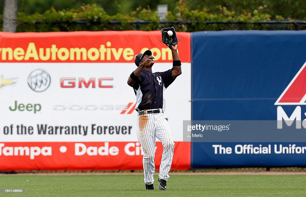 Outfielder Melky Mesa #63 of the New York Yankees catches a fly ball against the Boston Red Sox during a Grapefruit League Spring Training Game at George M. Steinbrenner Field on March 20, 2013 in Tampa, Florida.