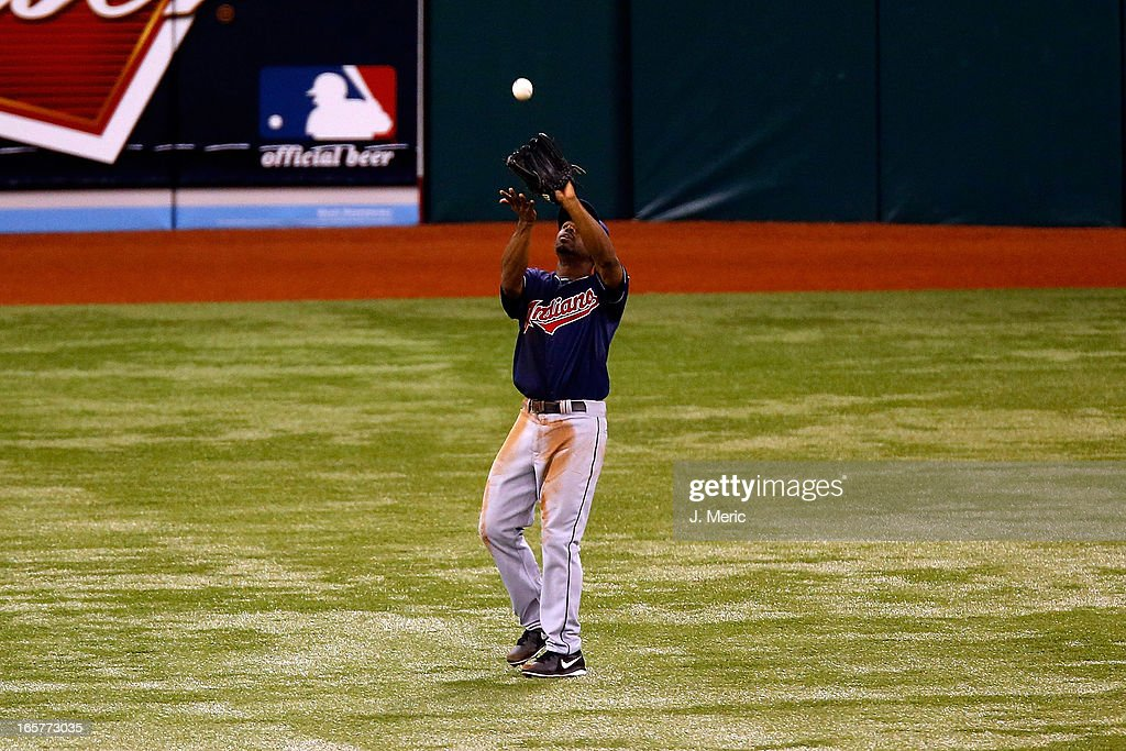 Outfielder <a gi-track='captionPersonalityLinkClicked' href=/galleries/search?phrase=Michael+Bourn&family=editorial&specificpeople=835742 ng-click='$event.stopPropagation()'>Michael Bourn</a> #24 of the Cleveland Indians catches a fly ball against the Tampa Bay Rays during the game at Tropicana Field on April 5, 2013 in St. Petersburg, Florida.