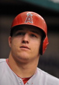 Outfielder Mike Trout of the Los Angeles Angels of Anaheim watches play against the Tampa Bay Rays August 29 2013 at Tropicana Field in St Petersburg...