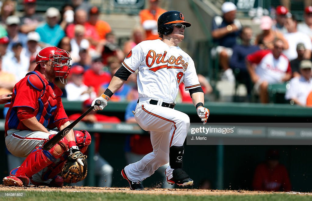 Outfielder Nate McLouth #9 of the Baltimore Orioles bats against the Philadelphia Phillies during a Grapefruit League Spring Training Game at Ed Smith Stadium on March 23, 2013 in Sarasota, Florida.