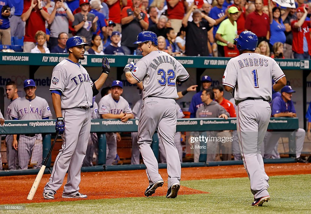 Outfielder <a gi-track='captionPersonalityLinkClicked' href=/galleries/search?phrase=Nelson+Cruz&family=editorial&specificpeople=235459 ng-click='$event.stopPropagation()'>Nelson Cruz</a> #17 of the Texas Rangers congratulates Josh Hamilton #32 after his home run against the Tampa Bay Rays during the game at Tropicana Field on September 8, 2012 in St. Petersburg, Florida.