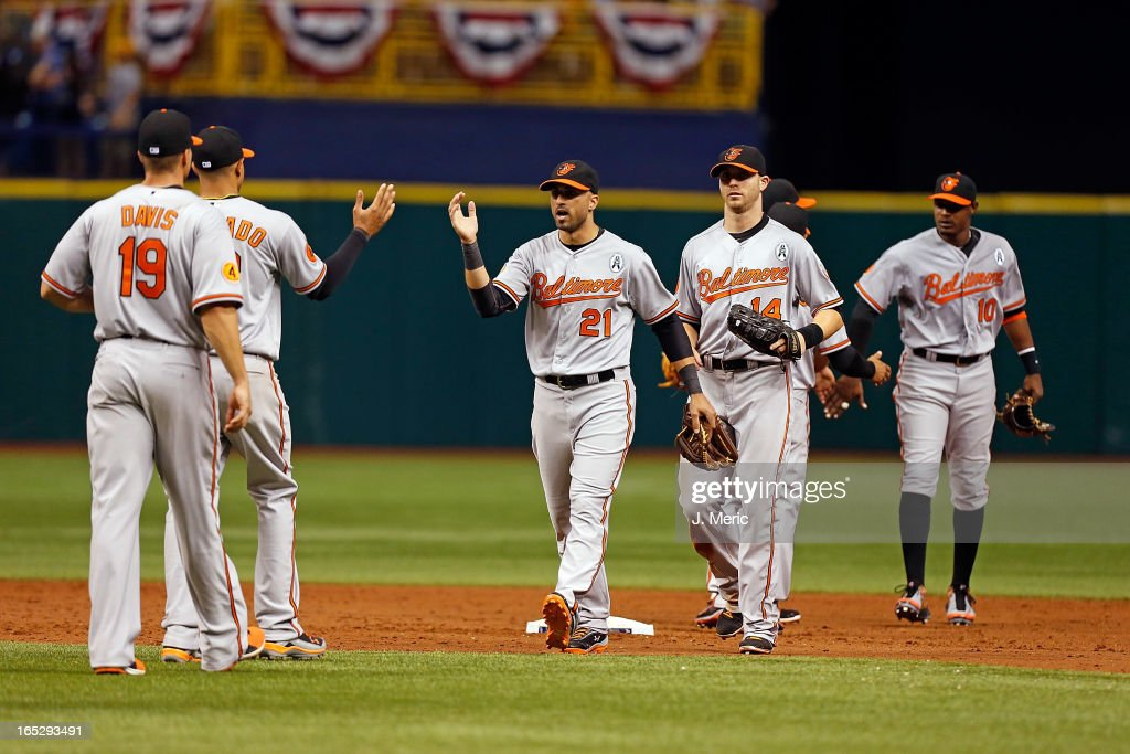 Outfielder <a gi-track='captionPersonalityLinkClicked' href=/galleries/search?phrase=Nick+Markakis&family=editorial&specificpeople=614708 ng-click='$event.stopPropagation()'>Nick Markakis</a> #21 of the Baltimore Orioles celebrates his team's 7-4 victory over the Tampa Bay Rays during the Opening Day game at Tropicana Field on April 2, 2013 in St. Petersburg, Florida.