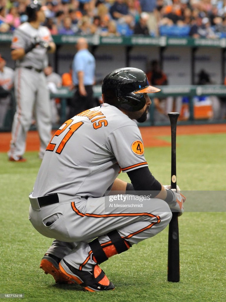 Outfielder Nick Markakis #21 of the Baltimore Orioles waits to bat during a pitching change by the Tampa Bay Rays September 22, 2013 at Tropicana Field in St. Petersburg, Florida.