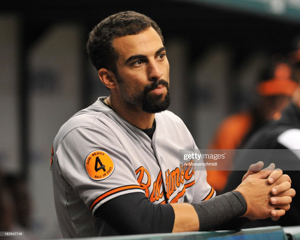 Outfielder Nick Markakis #21 of the Baltimore Orioles watches play against the Tampa Bay Rays September 23, 2013 at Tropicana Field in St. Petersburg, Florida.