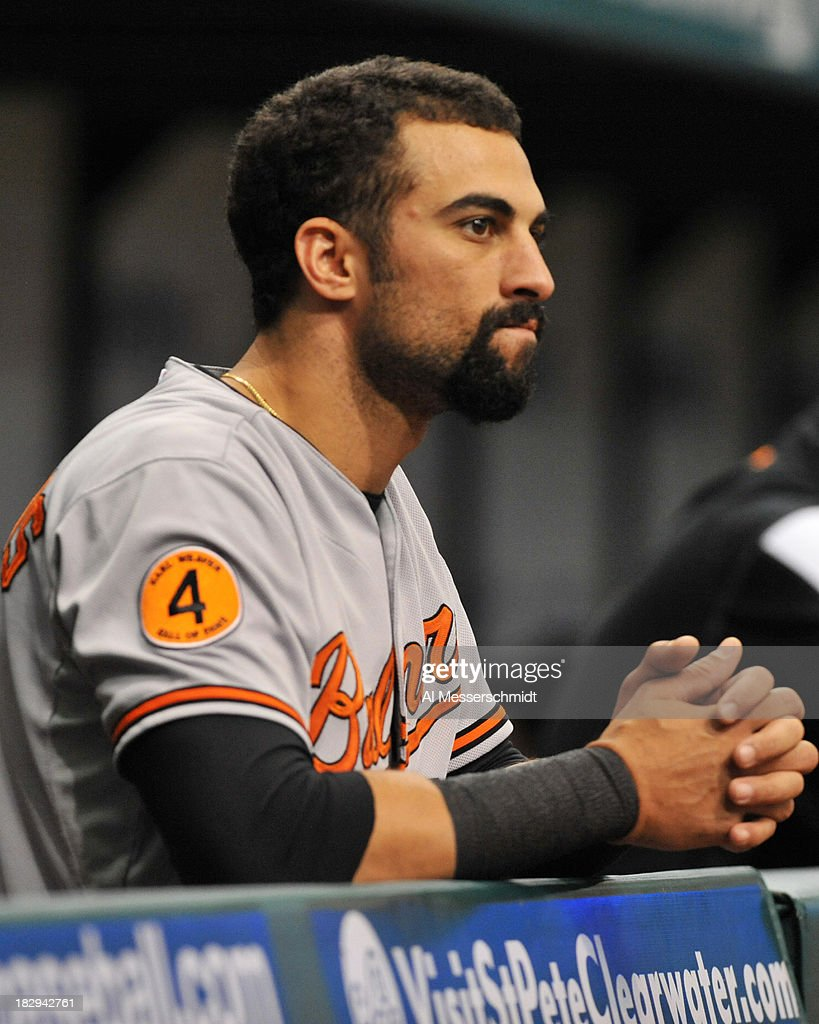 Outfielder Nick Markakis #21 of the Baltimore Orioles watches play against the Tampa Bay Rays September 23, 2013 at Tropicana Field in St. Petersburg, Florida. The Rays won 5 - 4.