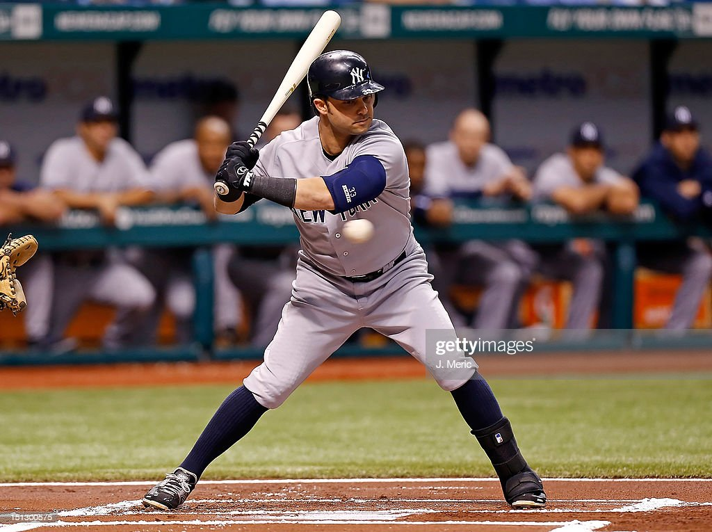 Outfielder <a gi-track='captionPersonalityLinkClicked' href=/galleries/search?phrase=Nick+Swisher&family=editorial&specificpeople=206417 ng-click='$event.stopPropagation()'>Nick Swisher</a> #33 of the New York Yankees watches strike three against the Tampa Bay Rays during the game at Tropicana Field on September 5, 2012 in St. Petersburg, Florida.