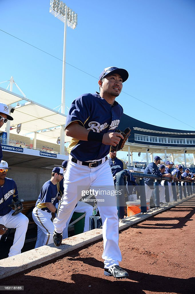 Outfielder Norichika Aoki #7 of Milwaukee Brewers looks on during spring training on March 3, 2013 in Phoenix, Arizona.
