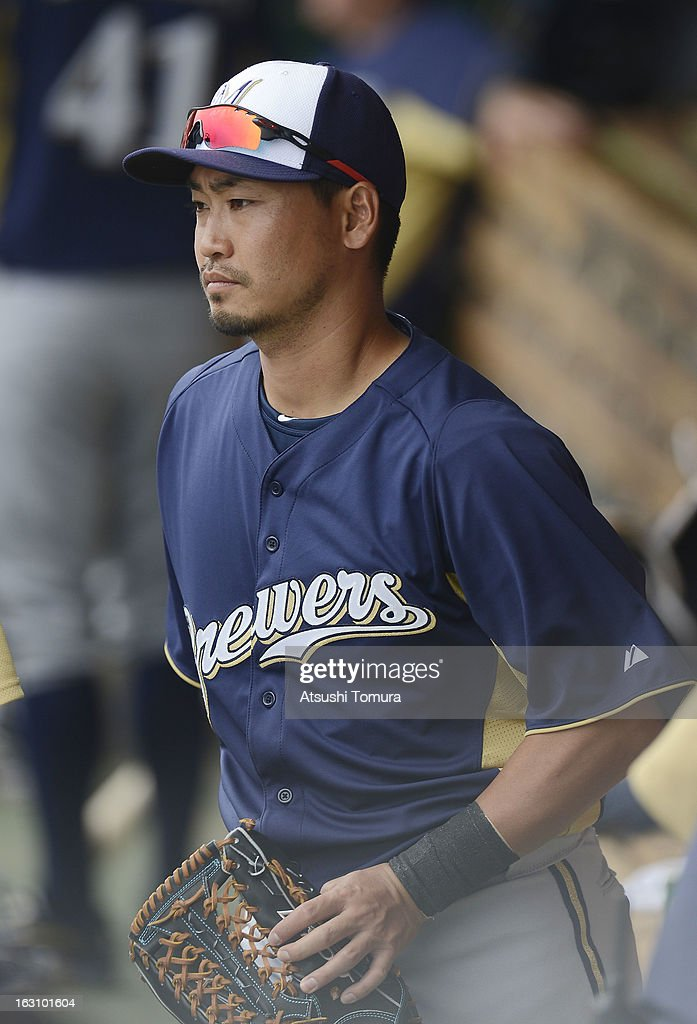 Outfielder Norichika Aoki #7 of Milwaukee Brewers looks on in the dugout during spring training match against Chicago Cubs on March 3, 2013 in Mesa, Arizona.