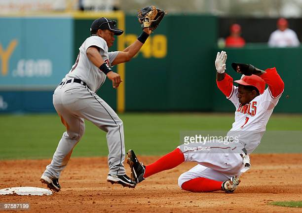 Outfielder Nyjer Morgan of the Washington Nationals steals second base ahead of the tag from shortstop Ramon Santiago of the Detroit Tigers at Space...