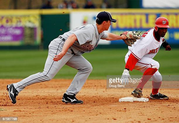 Outfielder Nyjer Morgan of the Washington Nationals steals second base ahead of the tag from second baseman Brent Dlugach of the Detroit Tigers at...
