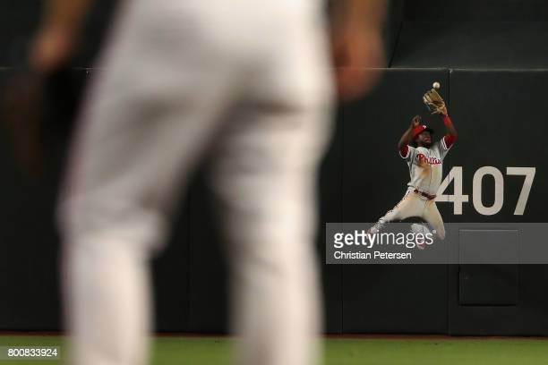 Outfielder Odubel Herrera of the Philadelphia Phillies makes a leaping catch against the Arizona Diamondbacks during the ninth inning of the MLB game...
