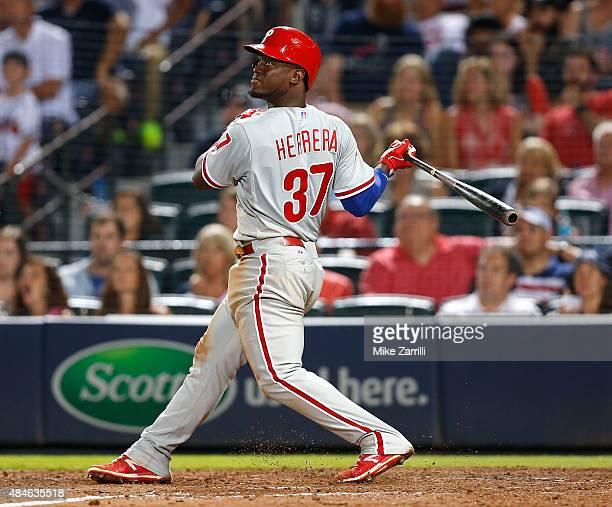 Outfielder Odubel Herrera of the Philadelphia Phillies swings during the game against the Atlanta Braves at Turner Field on July 3 2015 in Atlanta...