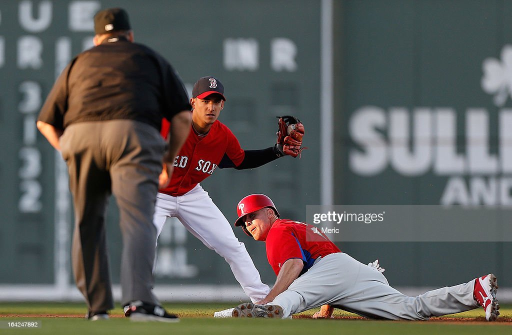 Outfielder Pete Orr of the Philadelphia Phillies steals second base as shortstop Jose Iglesias of the Boston Red Sox looks to the umpire for the call...